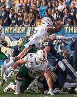 Miami running back Joseph Yearby attempts to dive into the endzone but fails. The Miami Hurricanes football team defeated the Pitt Panthers 29-24 on  Friday, November 27, 2015 at Heinz Field, Pittsburgh, Pennsylvania.