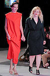 Graduating fashion student Lucy Trower, walks runway with model at the close of the 2013 Pratt Institute Fashion Show, on April 25, 2013.