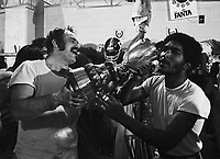 Moe Racine and Al Marcelin Ottawa Rough Riders drink from the Grey Cup in 1973. Copyright photograph Scott Grant
