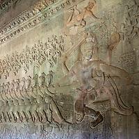 Cambodia, Angkor Wat.  Vishnu on Mount Mandara, leading the gods and the demons in the Churning the Sea of Milk, from the Hindu Creation Myth, the Bhagavata-Purana.  Indra is above Vishnu.  Asuras (demons, evil spirits) are to the left.  12th. Century.