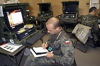 - Eurocorps, European multinational army corps, Polish officier in the field command post....- Eurocorps, corpo militare multinazionale europeo,..ufficiale polacco all'interno del posto di comando campale..