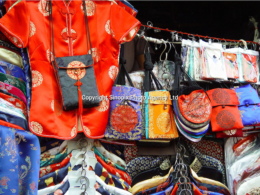 Some of the items tourists buy that are in Chinese style in the Silk Alley in the Central part of Beijing, China..02-SEP-02