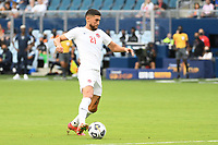 KANSASCITY, KS - JULY 11: Jonathan Osorio #21 of Canada with the ball during a game between Canada and Martinique at Children's Mercy Park on July 11, 2021 in KansasCity, Kansas.