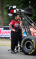 Aug. 5, 2011; Kent, WA, USA; NHRA top fuel dragster crew member for driver Larry Dixon during qualifying for the Northwest Nationals at Pacific Raceways. Mandatory Credit: Mark J. Rebilas-
