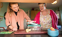 FAO: Society <br /> Pictured L-R: Alys Phillips helping resident Mandy Patton dice vegetables for lunch<br /> Re: Care worker Alys Phillips, 23, who looks after people with learning disabilities in Brecon, mid Wales, UK. Wednesday 01 February 2017