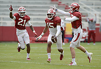 Arkansas defensive back Simeon Blair (15) celebrates an interception Saturday, April 3, 2021, with Montaric Brown (21) and Hudson Clark (right) during a scrimmage at Razorback Stadium in Fayetteville. Visit nwaonline.com/210404Daily/ for today's photo gallery. <br /> (NWA Democrat-Gazette/Andy Shupe)