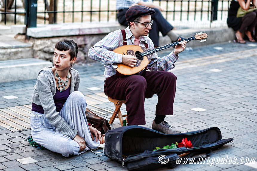 Musicians playing bouzouki in the street of Athens, Greece