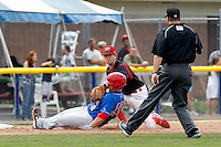 Batavia Muckdogs third baseman Danny Stienstra #2 tags Russell Moldenhauer #28 as he slides in to record the last out of the game as umpire Fernando Rodriguez looks on against the Auburn Doubledays at Dwyer Stadium on September 4, 2011 in Batavia, New York.  Batavia defeated Auburn 4-2.  (Mike Janes/Four Seam Images)