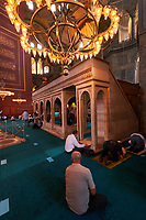 People praying inside Hagia Sophia mosque, Istanbul, Turkey