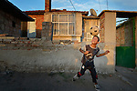 A boy prepares to head a soccer ball while playing football in the street in the largely Roma neighborhood of Gorno Ezerovo, part of the Bulgarian city of Burgas. Residents here don't self-identify much as Roma, because of the negative connotations associated with the word, so many refer to themselves as a Turkish-speaking minority.