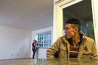 Adil Kheder Nimr, 27, (right) his wife Shatha Sulaiman Kheder, 27, and their son Steven Adil Kheder, 10 months, at home in their new apartment in Tukwila, Wash. on January 30, 2017. The family arrived in the United States as refugees from Iraq on January 19, 2017, the day after Donald Trump was sworn in as the 45th president of the United States,  They are concerned about thirteen of their family members still in Iraq. Trump signed an executive order last Friday   restricting immigration from seven Muslim countries, suspending all refugee admission for 120 days, and bans all Syrian refugees indefinitely.  (Photo by Karen Ducey)