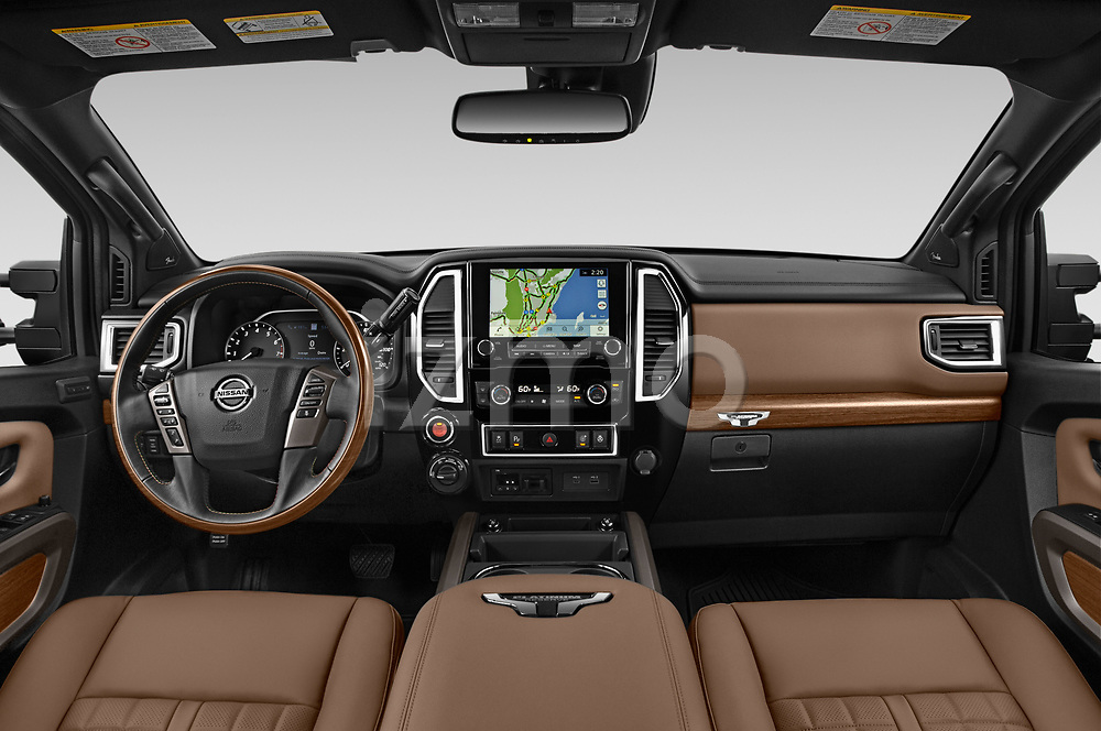 Stock photo of straight dashboard view of 2021 Nissan Titan-XD Platinum-Reserve 4 Door Pick-up Dashboard