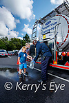 Aoife Gorham and her son Julien filling up water from a tanker with the help of Obi Madichie of the Civil Defence at the Brandon car park, Tralee on Wednesday.