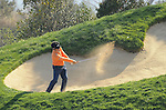 JEJU, SOUTH KOREA - APRIL 23:  Y.E. Yang of Korea plays a bunker shot on the 5th hole during the Round Two of the Ballantine's Championship at Pinx Golf Club on April 23, 2010 in Jeju island, South Korea. Photo by Victor Fraile / The Power of Sport Images