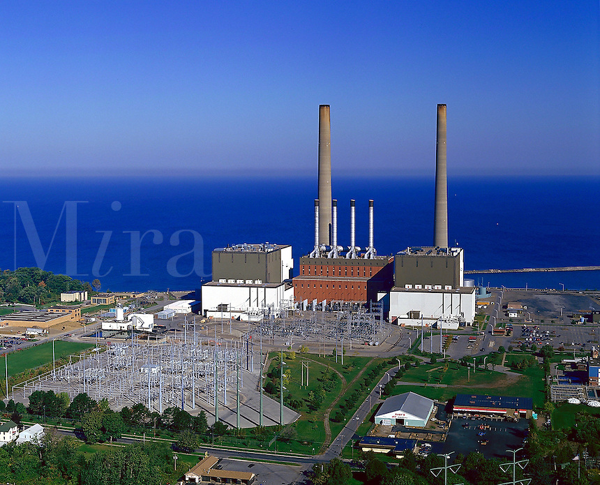 Oil burning electric power plant on the shore of Lake Ontario, electricity, energy, 08-6500. Oswego New York United States.