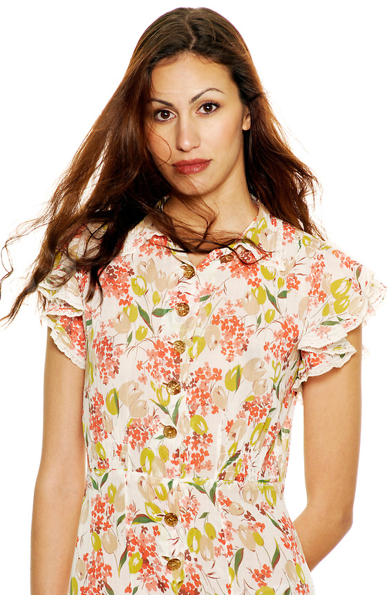 Attractive young woman in floral print summer dress.