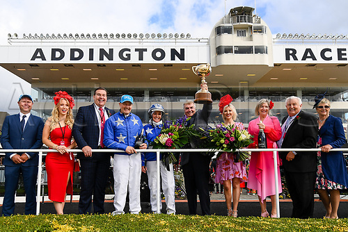 10th November 2020; Christchurch, New Zealand;  Hayden Cullen, Natalie Rasmussen, Mark Purdon with owners of Self Assured representative Trevor Casey holding the cup    during the NZ Trotting Cup at Addington Raceway, Christchurch, New Zealand