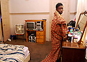 Thirteen-year-old Nathaniel Burton gets out of bed at 1 p.m. at his home where 15 people live, New Orleans, Wednesday, Dec. 19, 2007...(AP Photo/Cheryl Gerber)