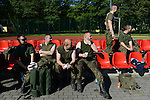 "Polish soldiers sit on the sidelines of a soccer match during a day off for cultural activities, which included sports games between the different participating armies in the NATO ""Saber Strike"" military exercises, in Drawsko Pomorskie, Poland on June 13, 2015.  NATO is engaged in a multilateral training exercise ""Saber Strike,"" the first time Poland has hosted such war games, involving the militaries of Canada, Denmark, Germany, Poland, and the United States."