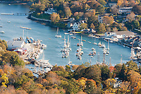 A birds-eye-view of Camden Harbor and surrounding fall foliage from Mt. Battie in Camden, Maine