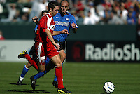 Ante Razov & Craig Waibel chase after a loose ball during MLS Cup 2003.  Waibel subsequently fouled Razov and was issued a yellow card caution.  The San Jose Earthquakes defeated the Chicago Fire 4-2 in the MLS Championship at The Home Depot Center on November 23, 2003.