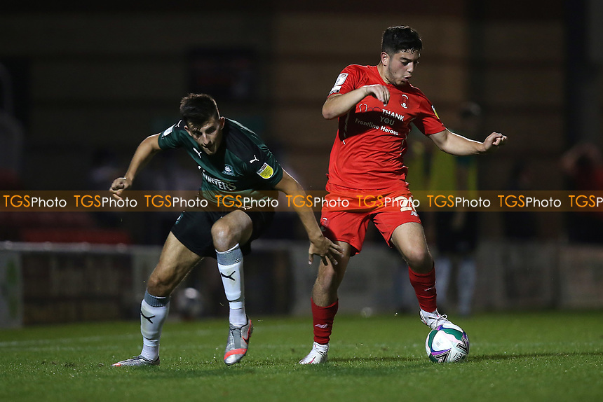 Ruel Sotiriou of Leyton Orient and Kelland Watts of Plymouth Argyle during Leyton Orient vs Plymouth Argyle, Caraboa Cup Football at The Breyer Group Stadium on 15th September 2020