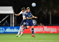 LAKE BUENA VISTA, FL - JULY 26: Johnny Russel of Sporting KC and Jake Nerwinski of Vancouver Whitecaps FC challenge for a header during a game between Vancouver Whitecaps and Sporting Kansas City at ESPN Wide World of Sports on July 26, 2020 in Lake Buena Vista, Florida.