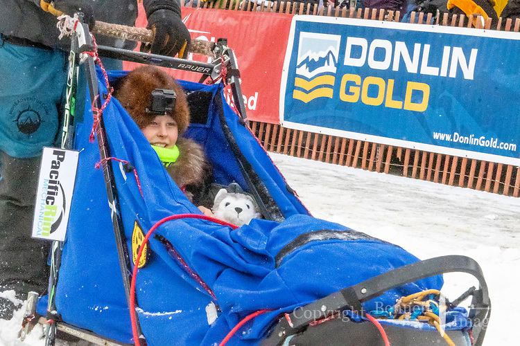 Riley Dyche and team leave the ceremonial start line with an Iditarider and handler at 4th Avenue and D street in downtown Anchorage, Alaska on Saturday March 7th during the 2020 Iditarod race.