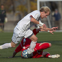 Rutgers University midfielder Nate Bourdeau (4) disrupts Boston College midfielder Kyle Bekker (10).  Rutgers University defeated Boston College in penalty kicks after two overtime periods in NCAA Division I tournament action, at Newton Campus Field, November 20, 2011.
