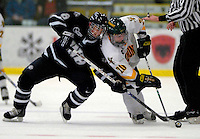"5 January 2007: University of New Hampshire forward Greg Collins (8) from Fairport, NY,battles Vermont forward Reese Wisnowski (20) from East Middlebury, VT at Gutterson Fieldhouse in Burlington, Vermont. The UNH Wildcats defeated Vermont 7-1 in front of a record setting 48th consecutive sellout at ""the Gut""...Mandatory Photo Credit: Ed Wolfstein Photo.<br />"