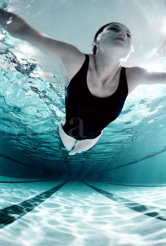 Woman swimming in a pool.