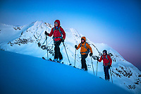 Ski touring in the pre-sunrise darkness while on the way to the Brunegghorn, Switzerland