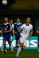 8th October 2020, Sarajevo Bosnia; European International Football Championships playoff,  Bosnia and Herzegovina versus Northern Ireland;  Miralem Pjanic Bosnia and Herzegovina watches as Jonny Evans of Northern Ireland chases the through ball