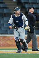 Georgetown Hoyas catcher Nick Collins (33) jogs up the first base line during the game against the Wake Forest Demon Deacons at Wake Forest Baseball Park on February 16, 2014 in Winston-Salem, North Carolina.  The Demon Deacons defeated the Hoyas 3-2.  (Brian Westerholt/Four Seam Images)