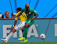 BRASILIA - BRASIL -19-06-2014. Juan Cuadrado (#11) jugador de Colombia (COL) disputa el balón con Didier Zokora (#5) jugador de  Costa de Marfil (CIV) durante partido del Grupo C de la Copa Mundial de la FIFA Brasil 2014 jugado en el estadio Mané Garricha de Brasilia./ James Rodriguez (#11) player of Colombia (COL) fights the ball with Didier Zokora (#5) player of Ivory Coast (CIV) during the macth of the Group C of the 2014 FIFA World Cup Brazil played at Mane Garricha stadium in Brasilia. Photo: VizzorImage / Alfredo Gutiérrez / Contribuidor