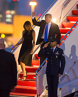 WEST PALM BEACH, FL - FEBRUARY 15: US President Donald Trump holds hands with his wife First Lady Melania Trump as they wave and greet supporters as they arrive on Air Force One at the Palm Beach International Airport to spend presidents day weekend at Mar-a-Lago resort , Earlier in the day Trump Declared a National Emergency to Build Border Wall on February 15, 2019 in West Palm Beach, Florida.<br /> <br /> <br /> People:  President Donald Trump, Melania Trump