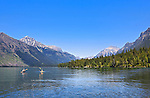 Boaters kayak Lake McDonald, gem of Glacier National Park in the U.S. State of Montana, at ten miles long and over a mile wide is the largest lake in the park.