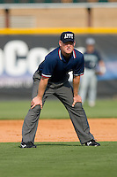 Umpire Jeff Morrow handles the calls on the bases during an Appalachian League game between the Pulaski Mariners and the Burlington Royals at Burlington Athletic Park August 4, 2009 in Burlington, North Carolina. (Photo by Brian Westerholt / Four Seam Images)