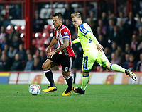 Nico Yennaris of Brentford avoids Matěj Vydra of Derby County during the Sky Bet Championship match between Brentford and Derby County at Griffin Park, London, England on 26 September 2017. Photo by Carlton Myrie / PRiME Media Images.