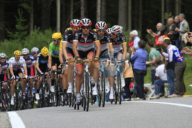 The peloton led by Yaroslav Popovytch (UKR) and the rest of the Radioshack-Nissan team climbs the Cote de Francorchamps during Stage 1 of the 99th edition of the Tour de France, running 198km from Liege to Seraing, Belgium. 1st July 2012.<br /> (Photo by Eoin Clarke/NEWSFILE)