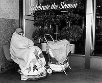 Homeless woman sleeping outside Filene's Department Store on Washington Street Boston MA November,1989
