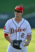 Center fielder Andrew Benintendi (2) of the Greenville Drive warms up with teammates prior to his first home game against the Greensboro Grasshoppers on Tuesday, August 25, 2015, at Fluor Field at the West End in Greenville, South Carolina. Benintendi is a first-round pick of the Boston Red Sox in the 2015 First-Year Player Draft out of the University of Arkansas. Greensboro won, 3-2. (Tom Priddy/Four Seam Images)