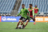 SEATTLE, WA - NOVEMBER 9: Victor Rodriguez #8 of the Seattle Sounders FC is defended by Cristian Roldan #7 at CenturyLink Field on November 9, 2019 in Seattle, Washington.