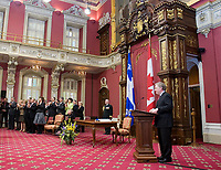 Quebec City, April 18, 2007 - The new Liberal cabinet cheers as Jean Charest at the Red room of the National assembly in Quebec City April 18, 2007. The cabinet is one of the smallest of the recent years and includes an equal number of men and women. Photo Francis Vachon for the Montreal Gazette.<br /> <br /> PHOTO :  Francis Vachon - Agence Quebec Presse