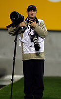 Photosport photographer Andrew Cornaga during the Investec Tri-Nations Bledisloe Cup match between the NZ All Blacks and Australia Wallabies at AMI Stadium in Christchurch on Saturday, 7 August 2010. Photo: Dave Lintott / lintottphoto.co.nz