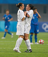 New Zealand forward (7) Ali Riley celebrates a goal with teammate Ria Percival during first round play in the 2008 Beijing Olympics at Qinhuangdao, China. .  Japan tied New Zealand, 2-2, at Qinhuangdao Stadium.