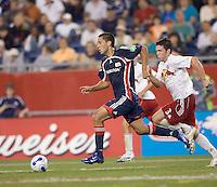 Danny O'Rourke (NY Red Bulls, white) chases a sprinting Clint Dempsey (NE Revolution, blue). NE Revolution defeat New York Red Bulls, 1-0, at Gillette Stadium on Sept. 9, 2006.