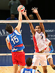 Puerto Rico's Josue Nunez hits against Dominican Republic blocker Tavares Frias during the Pan American Cup at the Reno Events Center in Reno, Nev., on Monday, Aug. 17, 2015. <br /> Photo by Cathleen Allison