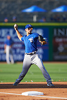 Dunedin Blue Jays third baseman Dickie Joe Thon (2) warms up in between innings during a game against the Clearwater Threshers on April 8, 2016 at Bright House Field in Clearwater, Florida.  Dunedin defeated Clearwater 8-3.  (Mike Janes/Four Seam Images)