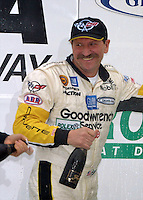 Dale Earnhardt celebrates with champagne after a 2nd place finish in the Rolex 24 at Daytona, Daytona INternational Speedway, Daytona Beach, FL, February 4, 2001. Earnhardt was killed on the final lap of the Daytona 500, two weeks later (Photo by Brian Cleary/www.bcpix.com)